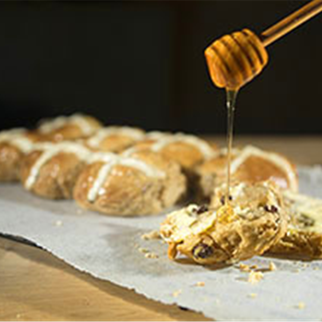 Home made hot cross buns with honey. Food Photography by Roy Mehta