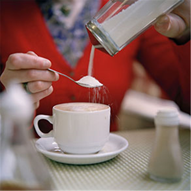 Pouring sugar into tea in a cafe photo by Roy Mehta