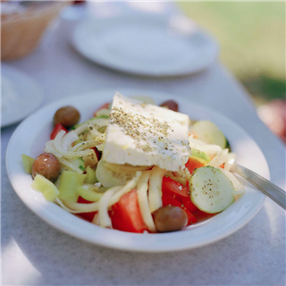 Greek Salad on a table. Mediterranean food. Photography by Roy Mehta