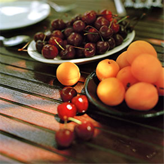 Fresh cherries, apricots in the sunlight on a  table in Skopelos, Greece photo by Roy Mehta